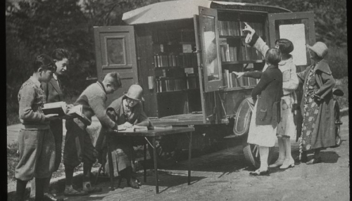 """Readers choosing books and checking them out"", ca. 1920s. Manuscripts and Archives Division, The New York Public Library"